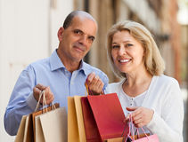 Aged couple with purchases Royalty Free Stock Photo