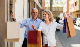 Aged couple with purchases Royalty Free Stock Image
