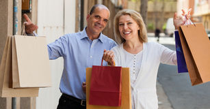 Aged couple with purchases Stock Images