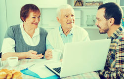 Aged couple signing agreement Royalty Free Stock Photo