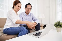 Aged couple watching videos royalty free stock photos