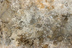 Aged cracked concrete stone plaster wall background Stock Photo