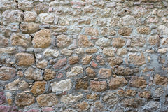 Aged cracked stone wall of a historical building Royalty Free Stock Photo