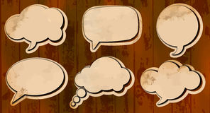 Aged cut out speech bubbles Stock Photo