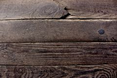 Aged dark brown wooden boards planks with metal nails as grunge wooden background. Aged tree boards Royalty Free Stock Images