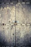 Aged dark vintage wooden door as background Stock Photography