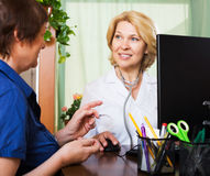 Aged doctor having positive news for a person Stock Photo