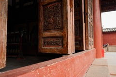 Aged door leaves with woodcarving of ancient Chinese building Royalty Free Stock Images