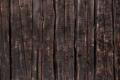 Dark wooden background, rough texture stock images
