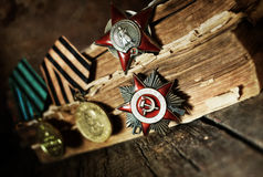 Aged effect medals world war great composition. Awards of Merit in World War II by the Soviet Union on a vintage wooden background Stock Photos