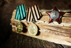 Aged effect medals world war great composition. Awards of Merit in World War II by the Soviet Union on a vintage wooden background Royalty Free Stock Photography