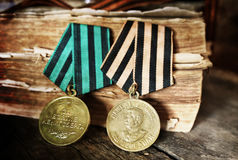 Aged effect medals world war great composition. Awards of Merit in World War II by the Soviet Union on a vintage wooden background Stock Photo
