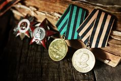 Aged effect medals world war great composition. Awards of Merit in World War II by the Soviet Union on a vintage wooden background Stock Photography