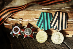 Aged effect medals world war great composition. Old military awards to participants of military operations during the Second World War Stock Photography
