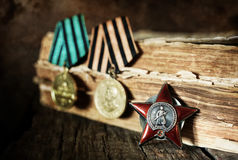Aged effect medals world war great composition. Old military awards to participants of military operations during the Second World War Stock Photo