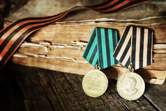 Aged effect medals world war great composition. Old military awards to participants of military operations during the Second World War Royalty Free Stock Photos