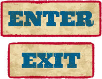 Aged enter and exit signs Stock Photos
