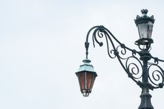 Aged european classic street lamp with broken on the apex royalty free stock image