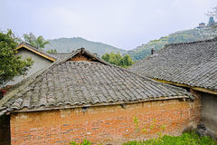 Aged farmhouses in mountains of sunny spring Stock Images