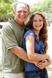 Aged father embracing her daughter Stock Image