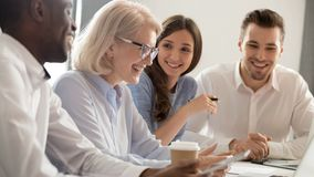 Free Aged Female Boss Positive Staff Working Together Sitting At Boardroom Stock Image - 160745691