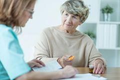 Aged female on medical consultation Stock Photo