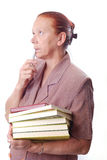 Aged female student with books. Aged female teacher or student is thinking Stock Photography