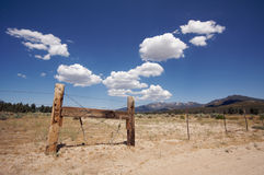 Aged Fence And Clouds Royalty Free Stock Photos