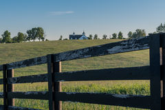 Aged Fence with Barn in Distance. In rural Kentucky Royalty Free Stock Images