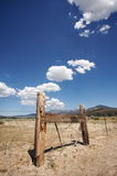 Aged Fence and Clouds Stock Image