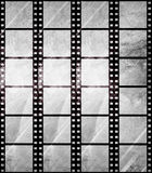Aged film strip in grunge style. With scratches Royalty Free Stock Photo