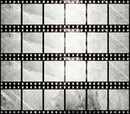 Aged film strip in grunge style. With scratches Royalty Free Stock Photography