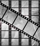 Aged film strip in grunge style. With scratches Stock Photography