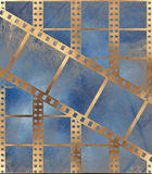 Aged film strip in grunge style. With scratches on burnt paper Royalty Free Stock Image