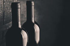 Aged fine wine bottles Royalty Free Stock Image