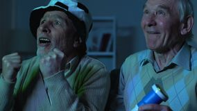 Aged football fans watching tv match cheering for favorite team, entertainment. Stock footage stock video footage