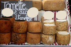 Aged french cheese wheels stacked Royalty Free Stock Photography