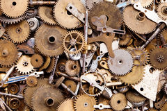 Aged gears cogwheels macro view. Steampunk mechanical equipment and mechanism background. Shabby grunge scratch metal Royalty Free Stock Images