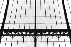 Aged glass and metallic building facade in black and white Royalty Free Stock Images