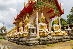 Aged golden buddha in row Stock Photos
