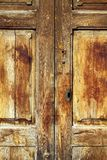 Aged golden weathered wooden door Stock Images