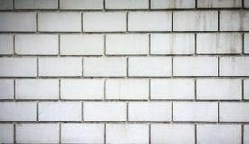 Aged gray brick wall Stock Images