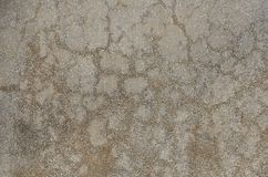 Aged gray surface of the artificial stone. Weathered surface of artificial stone made of mixture of mortar and tiny white marble pieces. Gray spotted stone stock images