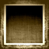 Aged Grunge Fabric. Vintage old linen brown tones grunge canvas texture fabric with lighter border and depth for a background design Royalty Free Stock Photo