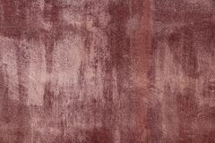 Aged grunge red cement paint wall texture Stock Images