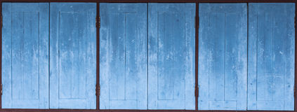 Aged grunge weathered blue door wood texture Stock Photos