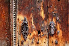 Aged grunge wood door weathered rusty handle Royalty Free Stock Photos