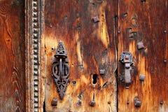 Aged grunge wood door weathered rusty handle. Aged grunge wood door weathered old rusty handle lock royalty free stock photos