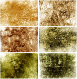 Aged Grungy Backgrounds. A set of six grungy aged backgrounds and textures Royalty Free Stock Image