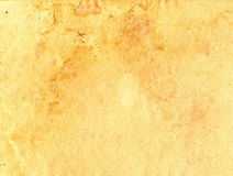 Aged grungy paper. Aged grungy brown paper background with stains stock images